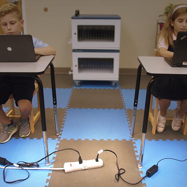 Power strips strewn accross classroom floor