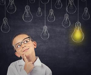 Student with light bulb shining above head.