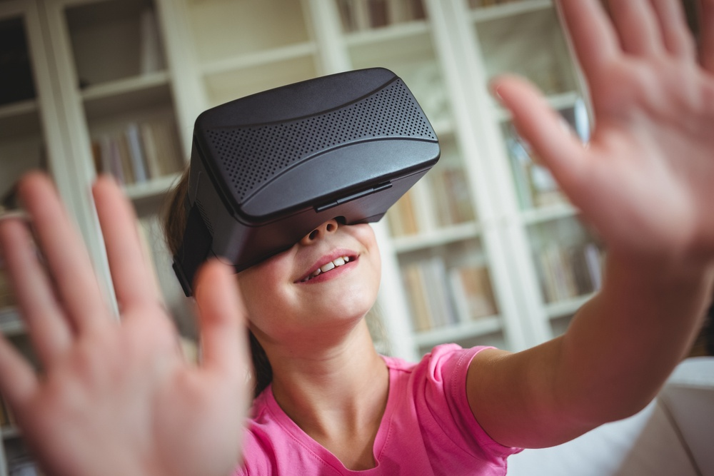 Girl looking through virtual reality headset in living room at home.jpeg