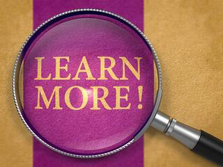 Learn More through Lens on Old Paper with Dark Lilac Vertical Line Background..jpeg