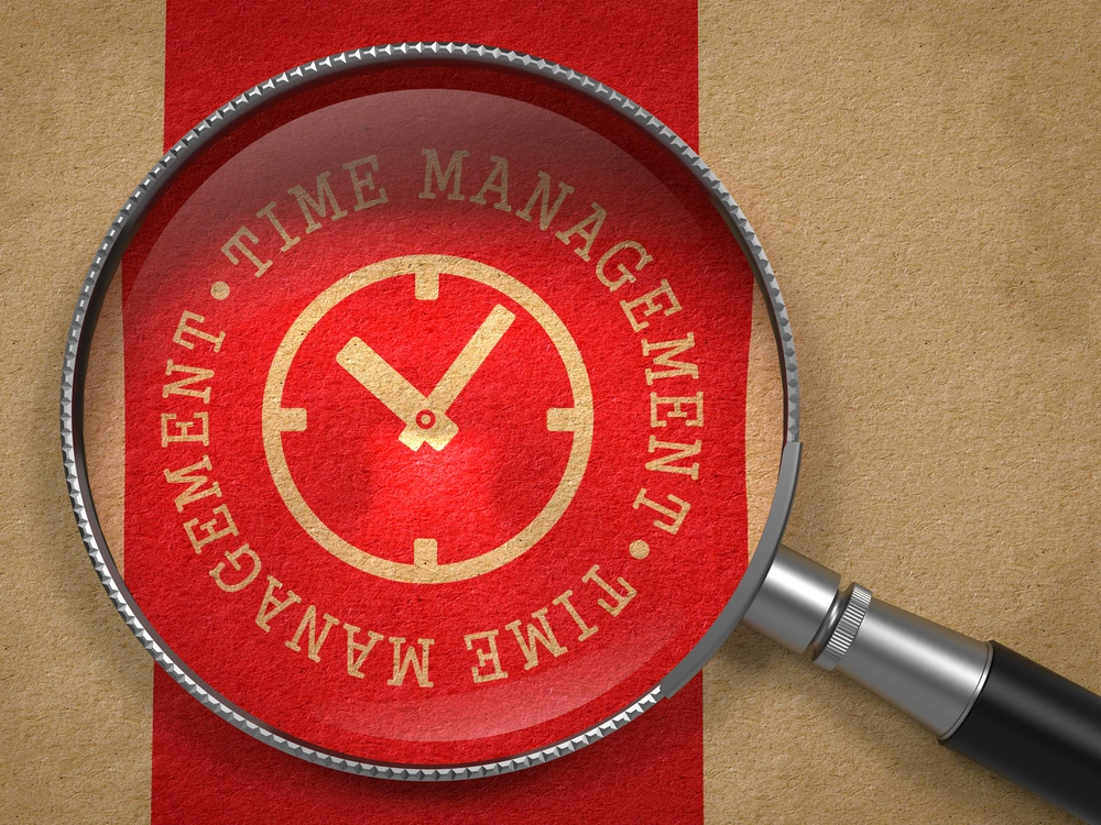 Magnifying Glass with Time Management Written Arround Icon of Clock Face on Old Paper with Red Vertical Line Background. Business Concept..jpeg