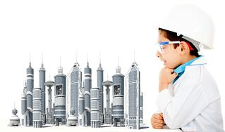 Young civil engineer with a city model - isolated over a white background.jpeg